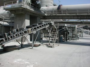 Scrap tires being processed by a shredding machine.