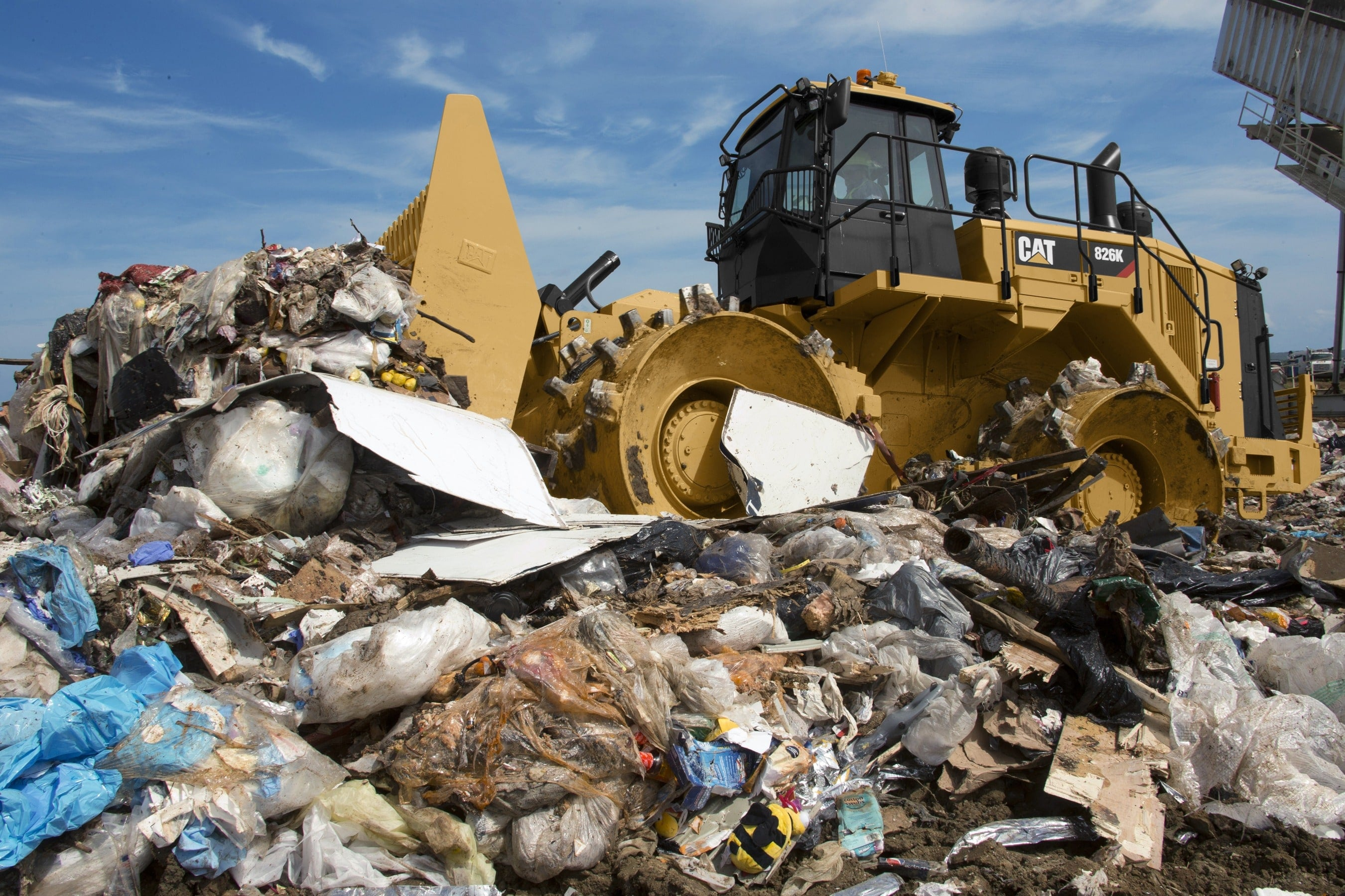 Caterpillar Landfill Compactor : Caterpillar works with m industries to expand range of